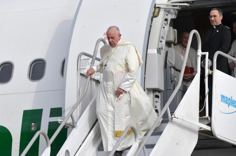 Pope Francis departs an airplane