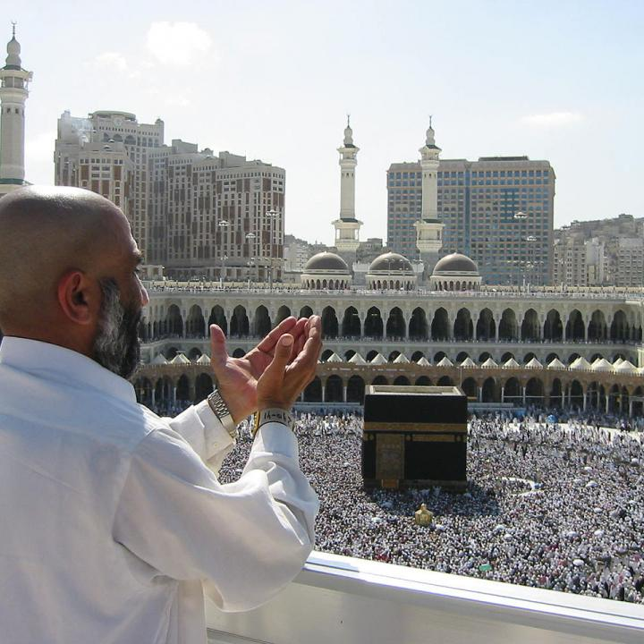 Muslim man praying at al-Aqsa Mosque in Mecca, Saudi Arabia.