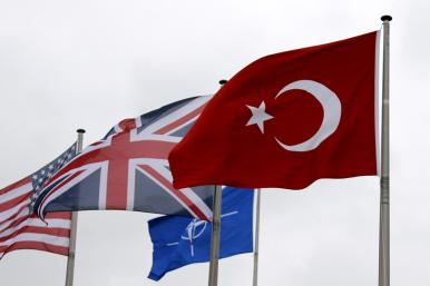 The flags of Turkey, the United States, United Kingdom, and NATO in Brussels