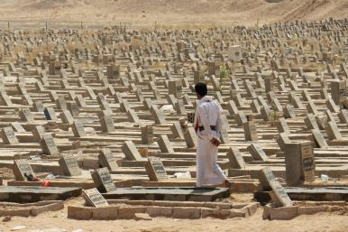 A man walks in a graveyard in Marib, Yemen