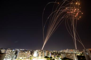 Photo showing the Iron Dome defense system intercepting Hamas rockets over Ashkelon, Israel, in May 2021.