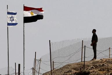 Egyptian and Israeli flags along the Sinai border