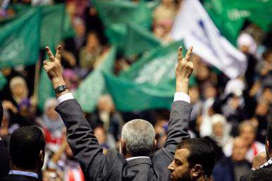 Hamas leader Ismail Haniyeh gestures to supporters