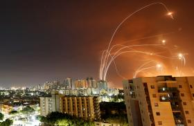 Iron Dome rockets intercepting Hamas missiles over Tel Aviv