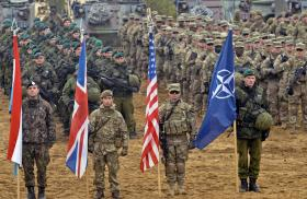 NATO solderis with alliance and national flags