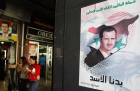 A pro-Assad election poster in Syria